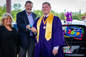 Stephen Manley handing the keys to Corbin Beller